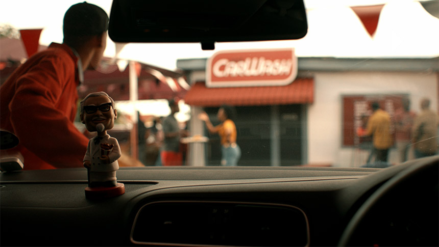 kfc bobblehead on car dashboard